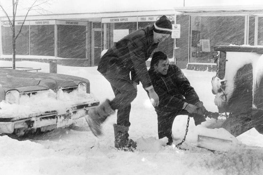 Daily News file photoThe snow storm of 1978 created lots of opportunities for motorists to get struck and need help from others. Photo: Nick King/Midland  Daily News