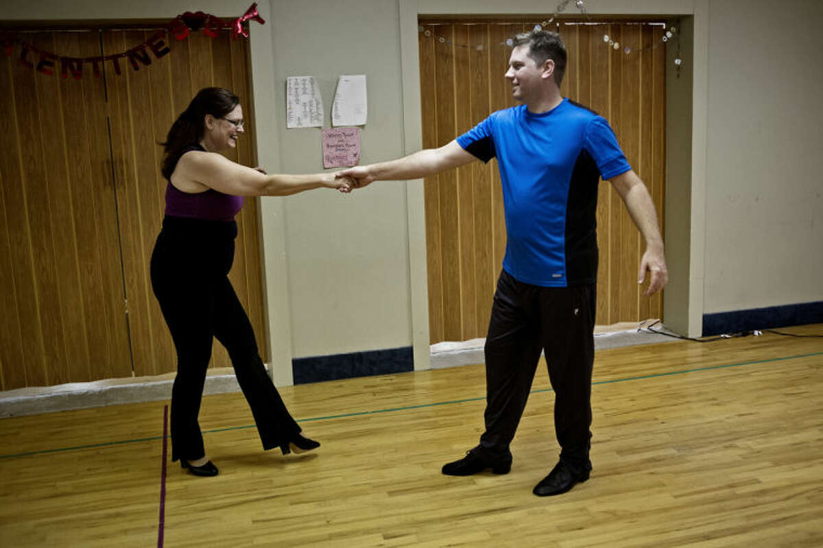 SEAN PROCTOR | sproctor@mdn.net Theresa Baker, left, of Bay City, and Mike Weinert, of Sanford, practice their dance routine during a dance practice for SwingShift and the Stars Wednesday evening at Expressions in Motion Dance Studio in Bay City. Weinert, an employee of Garber Chevrolet in Midland, said he has never really danced before, and the practices were overwhelming at first. The first dance will be held on Friday, Feb. 14 at the Scottish Rite Masonic Temple in Bay City.