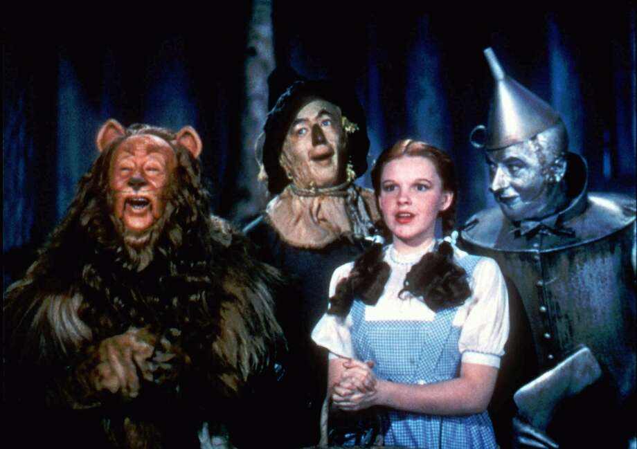 """The Cowardly Lion (Bert Lahr), The Scarecrow (Roy Bolger), Dorothy (Judy Garland), and The Tin Man (Jack Haley) traverse a danger-filled Yellow Brick Road in """"The Wizard of Oz"""" (1939).   Photo: Courtesy of Warner Home Video Photo: Courtesy Of Warner Home Video"""