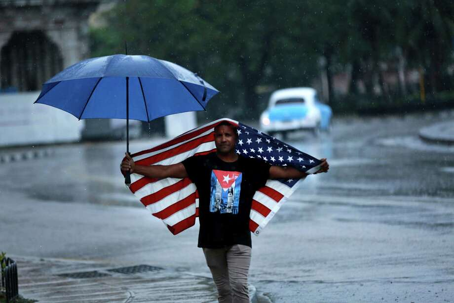 A Cuban man draped in an American flag on the route of Obama's Havana motorcade on Sunday. Photo: Noah Friedman-Rudovsky, For The Washington Post / The Washington Post