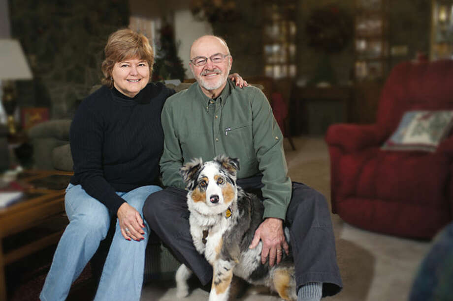Photo providedCurt Campbell, of Auburn, poses with two of the team members who helped him recover from esophageal cancer — his wife, Carol, and Aussie dog, CeCe. Other members of the team were his physicians and health care professionals associated with MidMichigan Health and the University of Michigan Health System.
