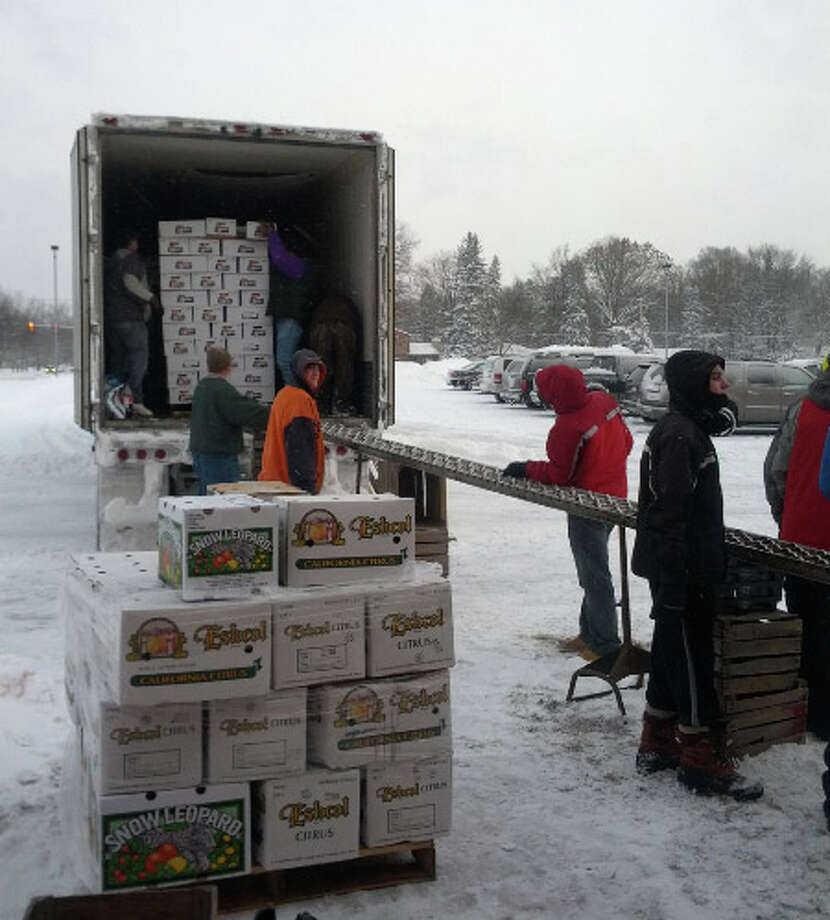 Photo providedDow High music students brave the snow to unload more than 2,000 cases of fresh citrus last February. The annual fruit sale funds key aspects of Dow High's award-winning music programs.