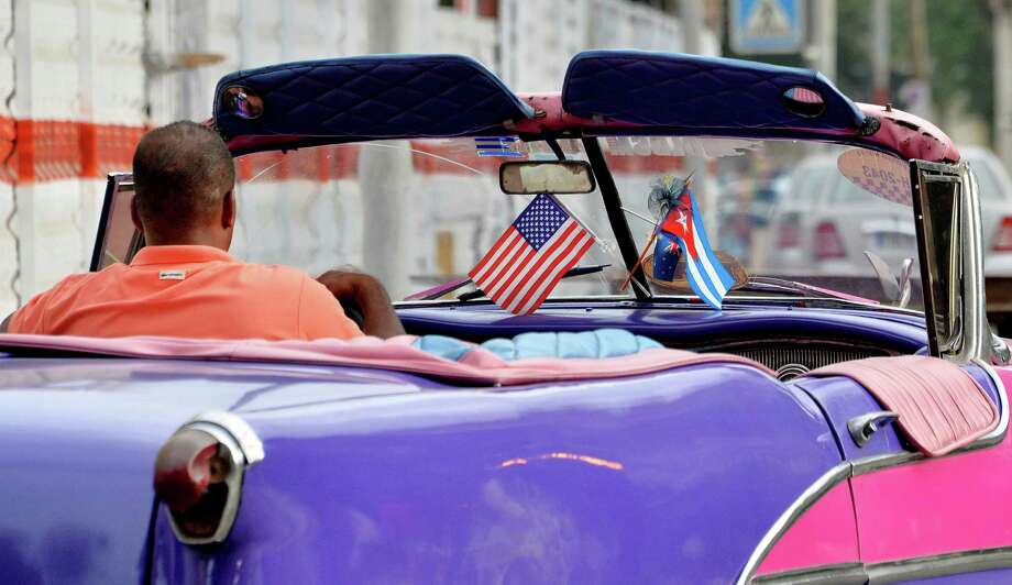 A car displays a U.S. flag display in downtown Havana on Saturday, March 19. Photo: Olivier Douliery, TNS / Abaca Press