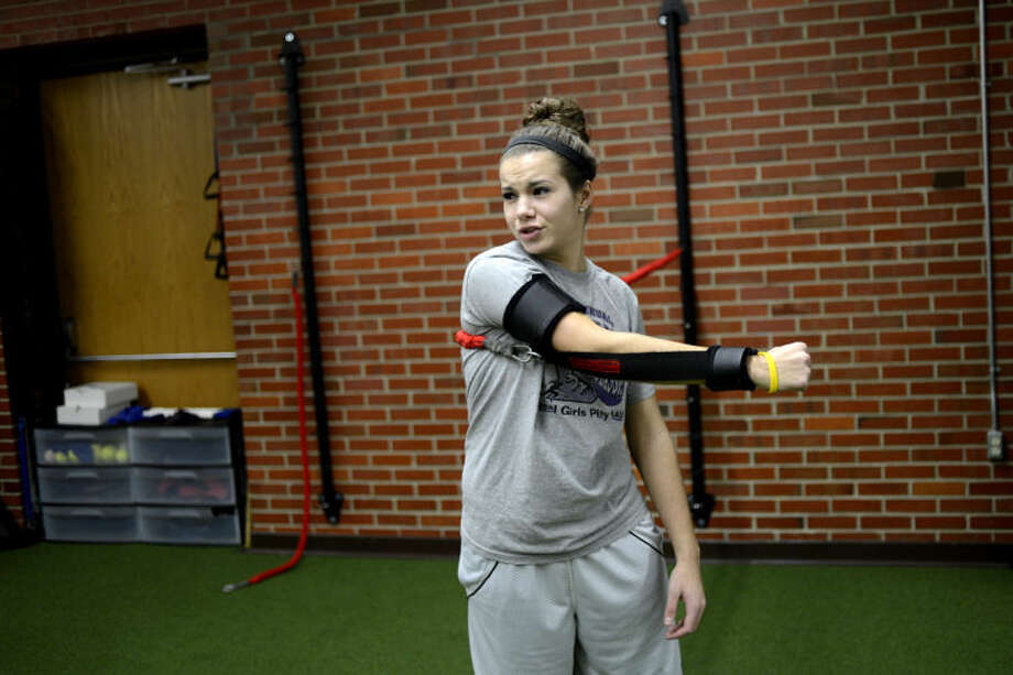 NICK KING | nking@mdn.netMidland High student Taylor Seipke, 16, works her shoulder during a session at Athletic Republic at the Midland Community Center. Seipke is getting ready for the upcoming softball season. Photo: Nick King/Midland  Daily News
