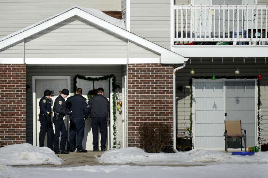 NICK KING | nking@mdn.netMidland Police investigate at the Village at Joseph's Run apartment complex today after a 31-year-old woman was found dead of an apparent gunshot wound. Photo: Nick King/Midland  Daily News