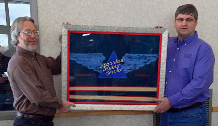 Photo providedGary Skory, director of the Midland County Historical Museum, presents the artifact to Brian McManus, Midland Barstow airport manager.