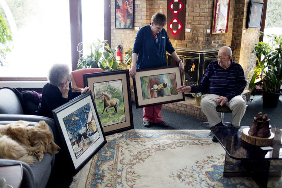 "NEIL BLAKE | nblake@mdn.net Harold Kluck, 84, of Saginaw, discusses his life and his art during the ""Yes we can!"" Tuesday tea at Creative 360 as Linda Z. Smith, center, and Delores Furland of Midland hold his artwork. During the weekly tea, artists in the ""Yes we can!"" exhibit come in and talk about their work. ""Yes we can!"" is a program designed to recognize and honor artists who are 80 and over for their legacy of creativity. Next week, March 4, Sally Moss will speak. Photo: Neil Blake/Midland  Daily News"