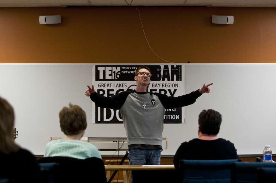 """Isaiah Marr, of Essexville, performs an original hip-hop piece during tryouts for Ten Sixteen Recovery Network's """"Recovery Idol"""" competition on Friday evening at the Midland Evangelical Free Church. The singing competition highlights the talents of those who have struggled with addiction. Photo: ZACK WITTMAN 