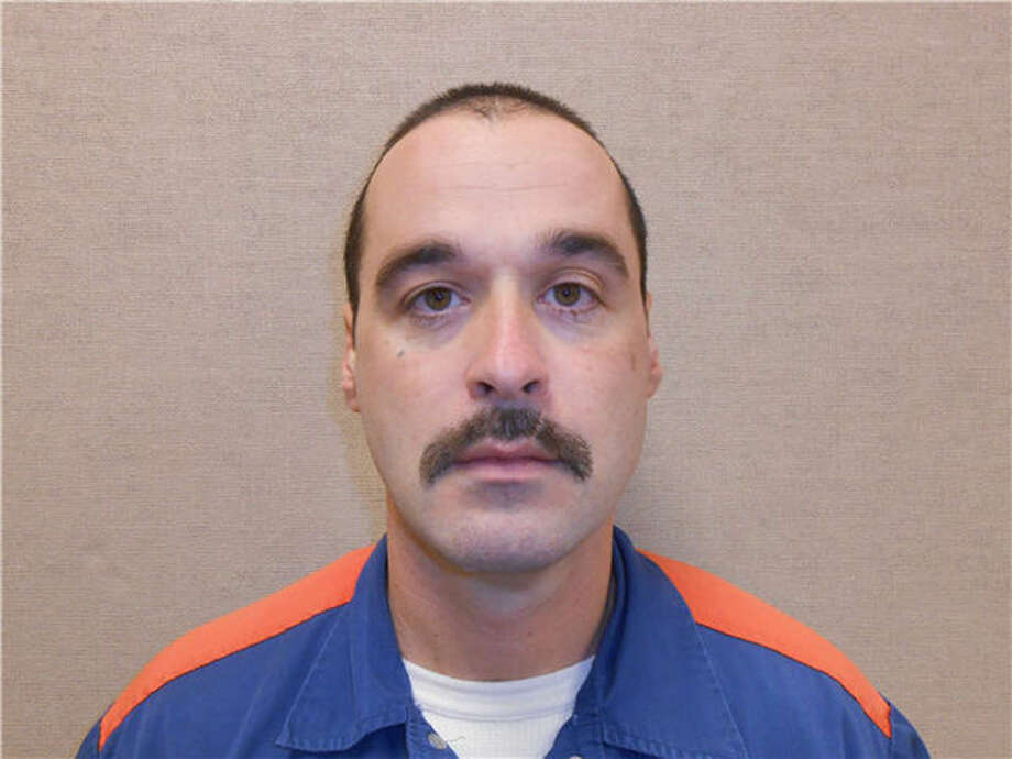 This Feb. 11, 2013 photo provided by the Michigan Department of Corrections shows Michael David Elliot. Elliot, who is serving life behind bars for murder in four 1993 deaths in Gladwin County, has escaped from prison and may have abducted a woman before she got away in Indiana, according to officials. Michigan Department of Corrections spokesman Russ Marlan says in an email that 40-year-old Elliot was discovered missing about 9:30 p.m. Sunday, Feb. 2, from the Ionia Correctional Facility in mid-Michigan. (AP Photo/Michigan Department of Corrections) Photo: Uncredited