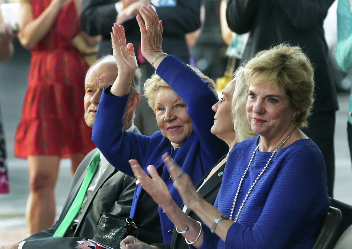 June Scobee Rodgers, center, raises her hands as she and Robert Zeigler, left; Gwen Griffen, second from right, and Jo-Carol Fabianke, far right, applaud at the grand opening of the Scobee Education Center at San Antonio College in Octoboer 2014. Fabianke is vice chancellor for academic success at the Alamo Colleges district.