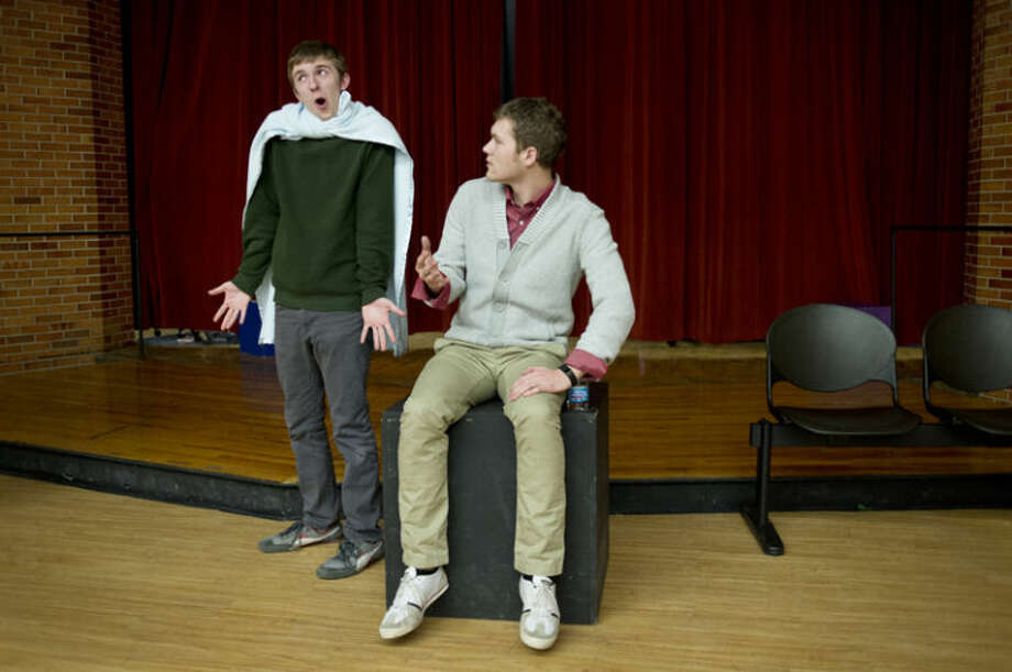H.H. Dow High School seniors Spencer Wejrowski, left, and Cole Lacey rehearse on Friday for Ren Fair. The theme for the show is from the comic strip Peanuts. The seniors, along with Andrew Brookens, Mary Bush and Mallory Fogus will be the MCs for the annual talent show which will be held at the Midland Center for the Arts at 7 p.m. on Saturday. Tickets are $15 for adults (18-65) and $10 for students and seniors. Photo: Neil Blake/Midland Daily News