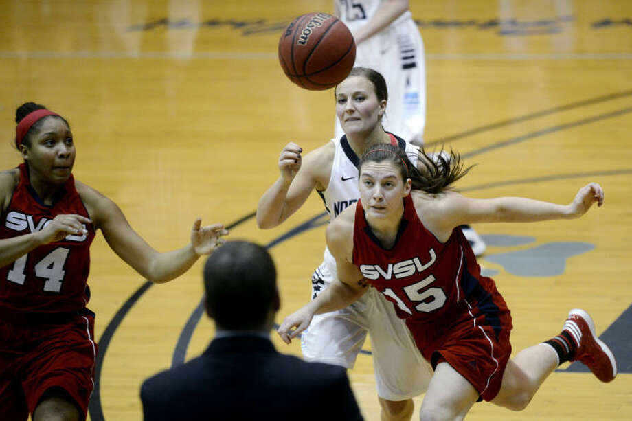 NICK KING | nking@mdn.netNorthwood's Gabrielle Rivette, center, SVSU's Kayla Womack, left, and Katelyn Carriere go for the ball during the second half Monday at Northwood University. SVSU won 67-61. Photo: Nick King/Midland  Daily News
