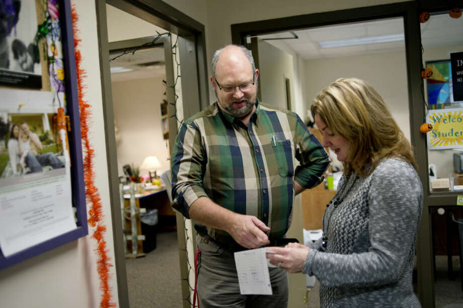 NICK KING | nking@mdn.netFamily and Children's Services child and youth coordinator, Outpatient Therapist Kim Sumerix, left, talks with Academic and Career Education Academy Principal Michelle Zielinski about possible student clients. Sumerix will see any student who wants counseling during his visits. Photo: Nick King/Midland  Daily News