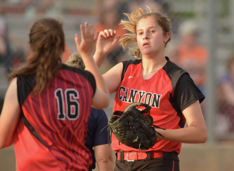 New Braunfels Canyon pitcher Brooke Vestal (right) high-fives teammate Nicole Flitton during Game 2 of their Class 6A second-round playoff series against Brandeis in 2015. Photo: Robin Jerstad /San Antonio Express-News