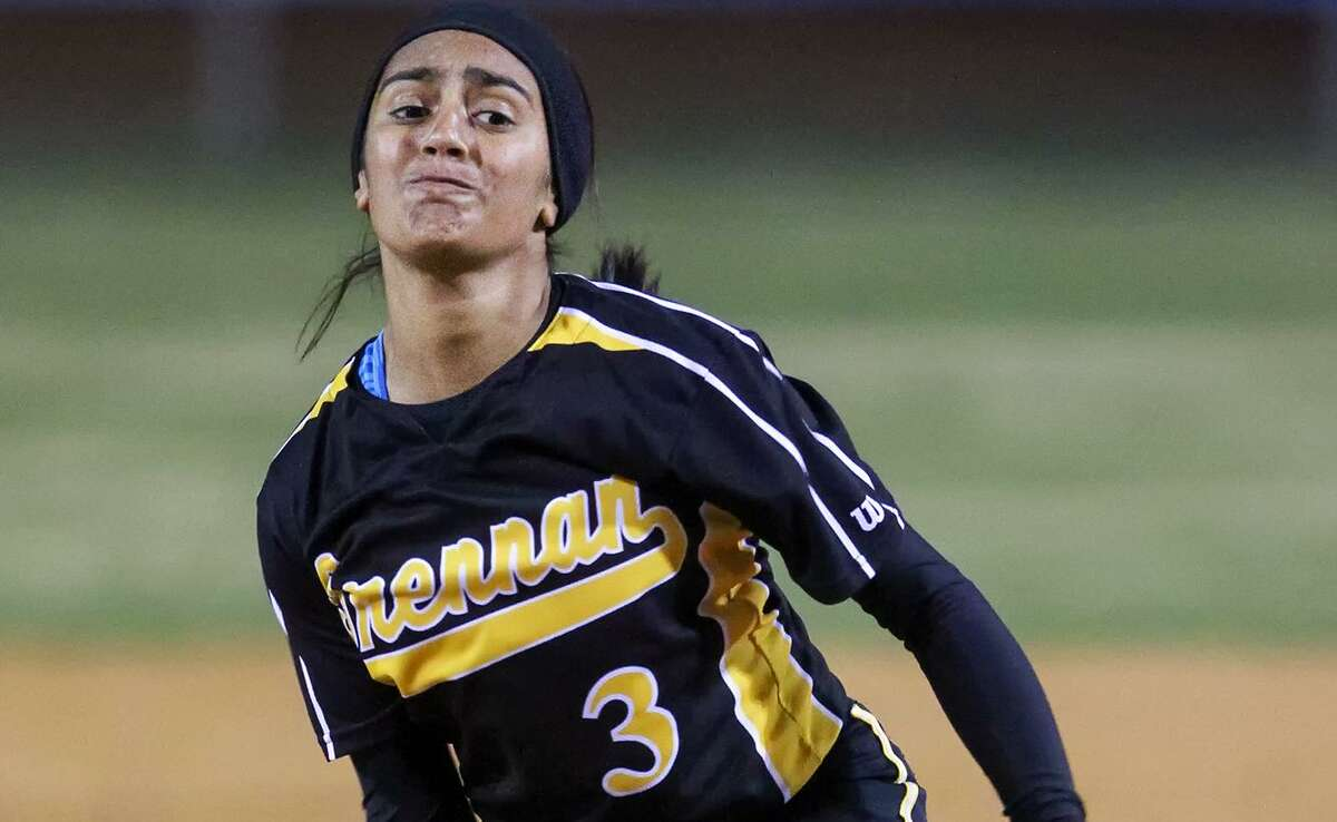 Iliana Martinez of Brennan throws to the plate during their game with Brackenridge at the Mary Ann Villarreal Softball Complex on March 4, 2014.