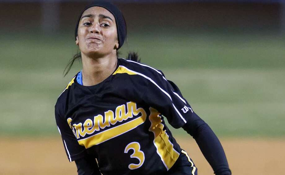 Iliana Martinez of Brennan throws to the plate during their game with Brackenridge at the Mary Ann Villarreal Softball Complex on March 4, 2014. Photo: Marvin Pfeiffer /San Antonio Express-News / Express-News 2014