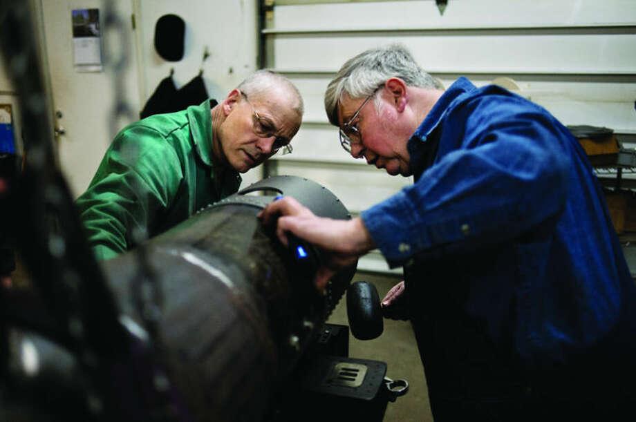 NEIL BLAKE | nblake@mdn.net Marty Knox, right, and Glenn Grasley work on a boiler in the Ridge Locomotive Works workshop on Tuesday. Photo: Neil Blake/Midland  Daily News