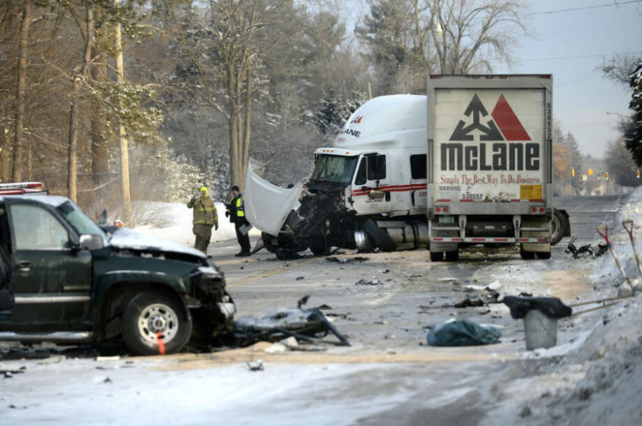 NICK KING | nking@mdn.netMidland police and fire department officials work the scene of a fatal accident Monday morning on Eastman Avenue between St. Andrews and Sugnet roads. All lanes of traffic were closed while crews worked to clean up the site. Photo: Nick King/Midland  Daily News