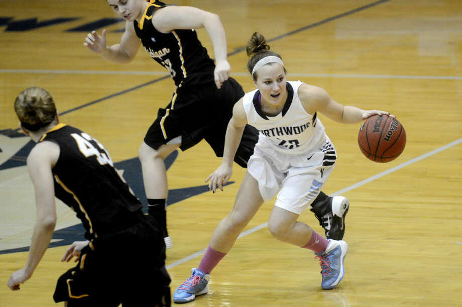 NICK KING | nking@mdn.netNorthwood's Gabrielle Rivette, right, steals the ball as Michigan Tech's Mackenzie Perttu, center, and Paige Albi look on during the first half Thursday at Northwood University. Northwood won 80-58. Photo: Nick King/Midland  Daily News