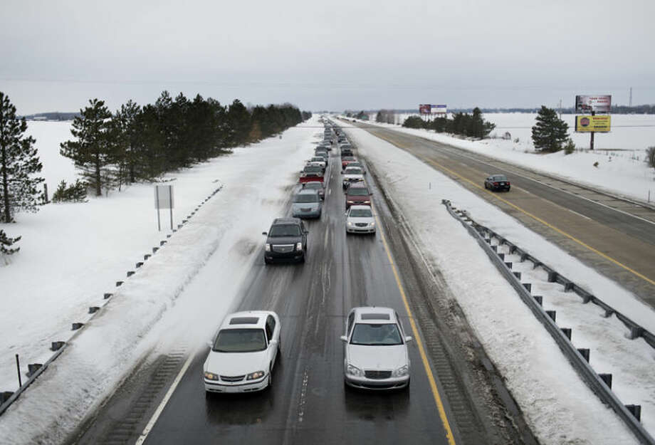 Traffic on eastbound U.S. 10 was backed up for miles Friday as emergency crews cleared multiple accidents on the expressway. Blowing snow created icy conditions on sections of the road. Photo: Neil Blake/Midland  Daily News