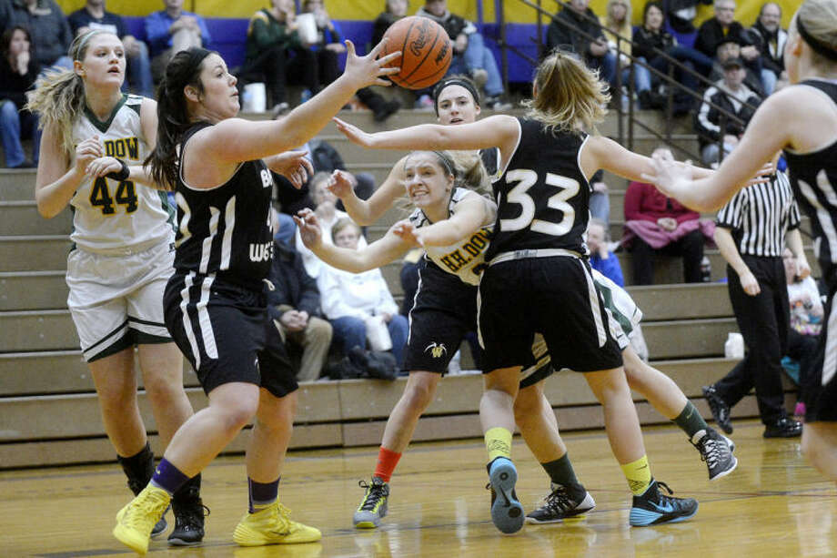 NICK KING | nking@mdn.netDow's Emily Lyman, center, is fouled after being pressured by Bay City Western players, from left, Stephanie Pajot, Madison Brewer and Ashtyn Decatur during the first quarter Wednesday at Bay City Central High School. Miller' teammate, Erin O'Neil, far left, looks on. Dow won 58-35. Photo: Nick King/Midland  Daily News