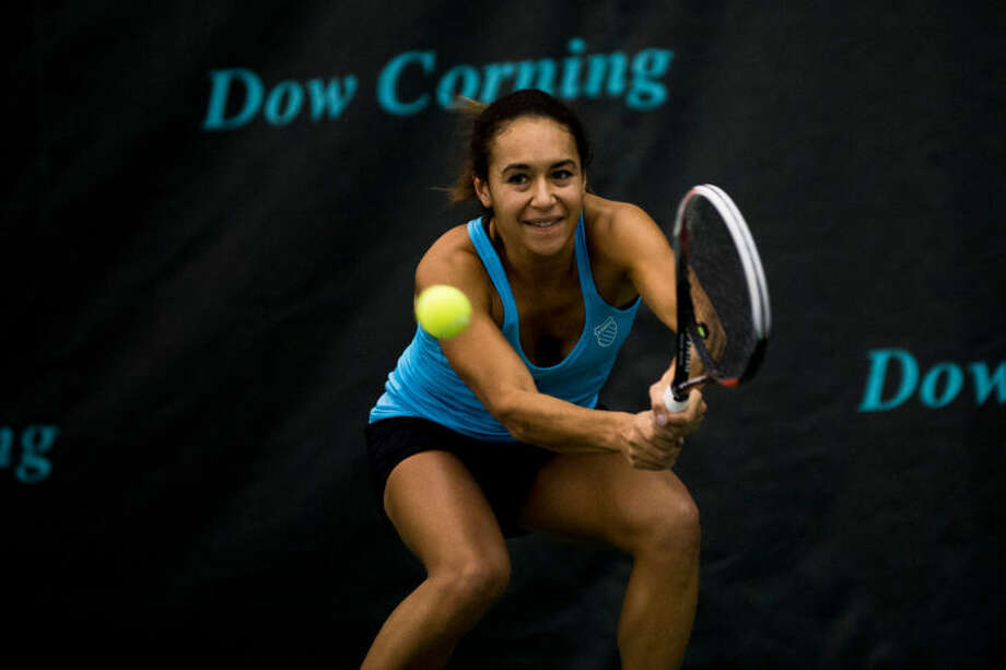 ZACK WITTMAN | for the Daily NewsBritish player Heather Watson returns the ball to Russian player Ksenia Pervak at the Dow Corning Singles Tennis Championship on Sunday afternoon at the Midland Community Tennis Complex. Photo: Sean Proctor/Midland  Daily News