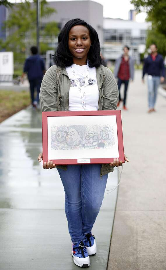 """Akilah Johnson, 15, poses for a photograph with her framed doodle on the Google campus in Mountain View, California, on Monday, March 21, 2016. Akilah's drawing """"My Afrocentric Life"""" won this year's """"Doodle 4 Google"""" competition. Photo: Connor Radnovich, The Chronicle"""