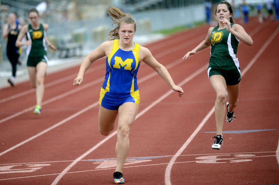 NICK KING | nking@mdn.netMidland's Kailey Warner, left, crosses the finish line followed by Dow's Sophie Roder during the 100 meter dash Tuesday at Dow High School. Photo: Nick King/Midland  Daily News