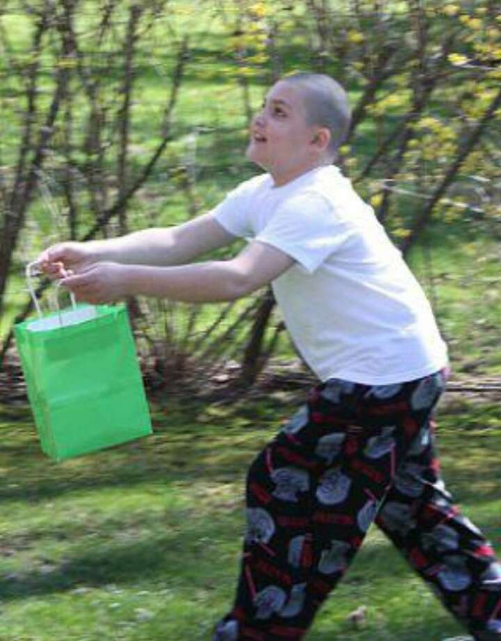 Dylan Fortunato, 9, trying to catch an Easter egg at a recent Easter event. Photo: Contributed Photo / Connecticut Post Contributed