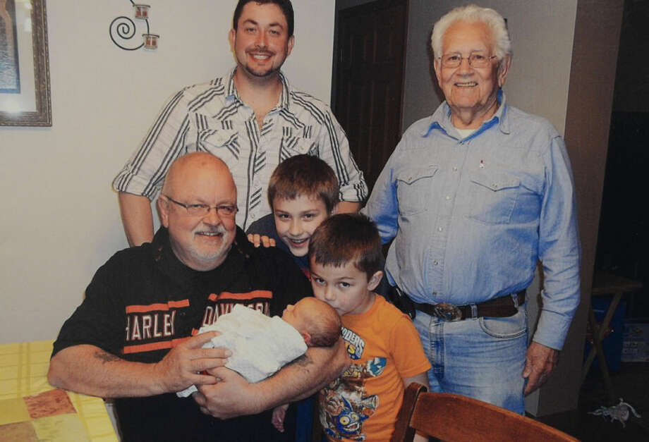 In back are Josh Miller and Bob Miller, who began City Sewer Cleaners 63 years ago in Midland. Holding baby Isaac is David Miller, who owns the business today. Grandson Gabriel is peeking over David's shoulder and Tryston is kissing baby Isaac. Gabriel, Tryston and Isaac are Josh's sons, which makes Bob a great-grandfather. Photo: Photo Provided