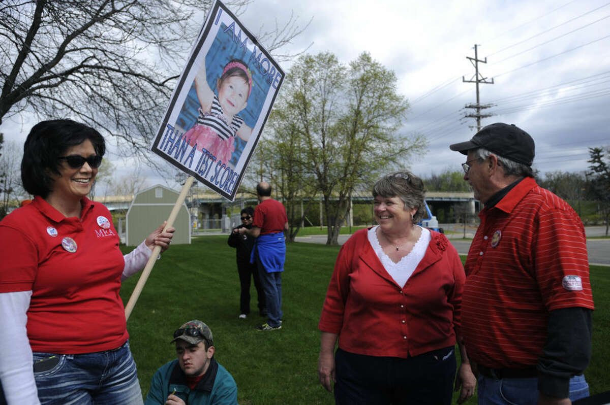 """In this Midland Daily News file photo, Tammy Lewis, a-then second grade teacher in Gladwin, Renaye Baker, of the Michigan Education Association, and Fred Sprague, a candidate for state senate, chat after a rally to raise awareness about education issues. """"We need people in power who understand the need to support public education,"""" says Lewis, who was teaching at Harrison Elementary."""