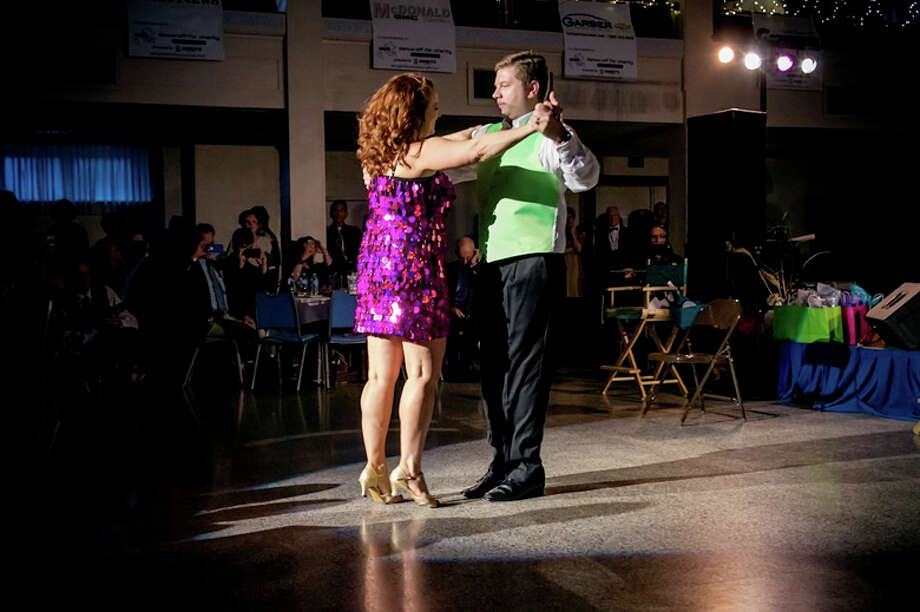 Mike Weinert, general manager of Garber Chevrolet, and Theresa Baker dance a cha-cha for the Diaper Alliance. Photo: ERIC FLETCHER PHOTOGRAPHY
