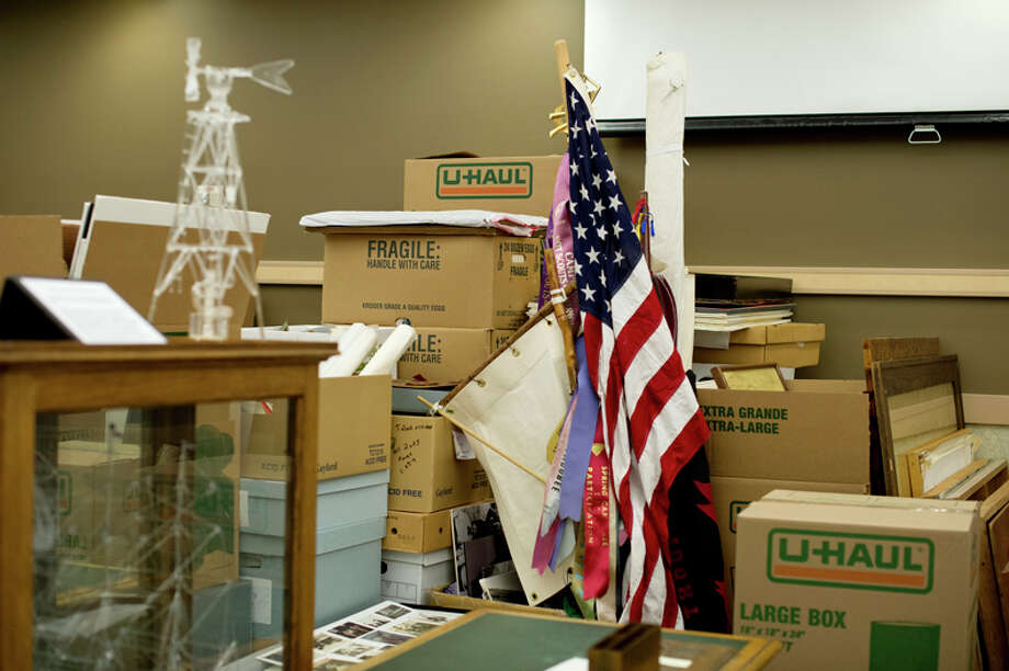 Flags sit among piles of organized and stacked boxes at the Herbert D. Doan Midland County History Center on Friday. Photo: Neil Blake/Midland Daily News / Midland Daily News