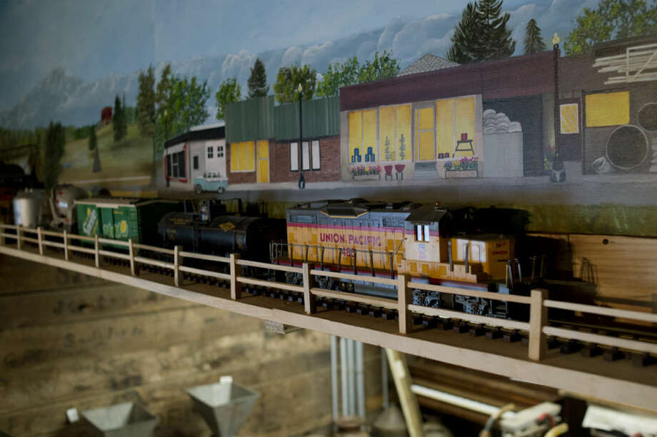NEIL BLAKE | nblake@mdn.netA model train sits on a track that circles the interior of the depot at the Sanford Centennial Museum. The train is a new edition to the museum, which opens Saturday. Mary Hughes painted the mural of Sanford that sits behind a section of the train track and John Billingsley engineered and built the platform that the train rides on. He cut 300 rails and 150 posts for the fence that surrounds the track. Photo: Neil Blake/Midland Daily News