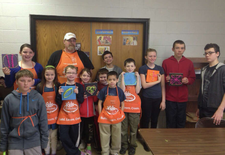 Youths involved in the Vacation Bible School at the Salvation Army were assisted by Home Depot staff and donations. The donations were a perfect fit, as the theme this year was Workshop of Wonders. Photo: Photo Provided