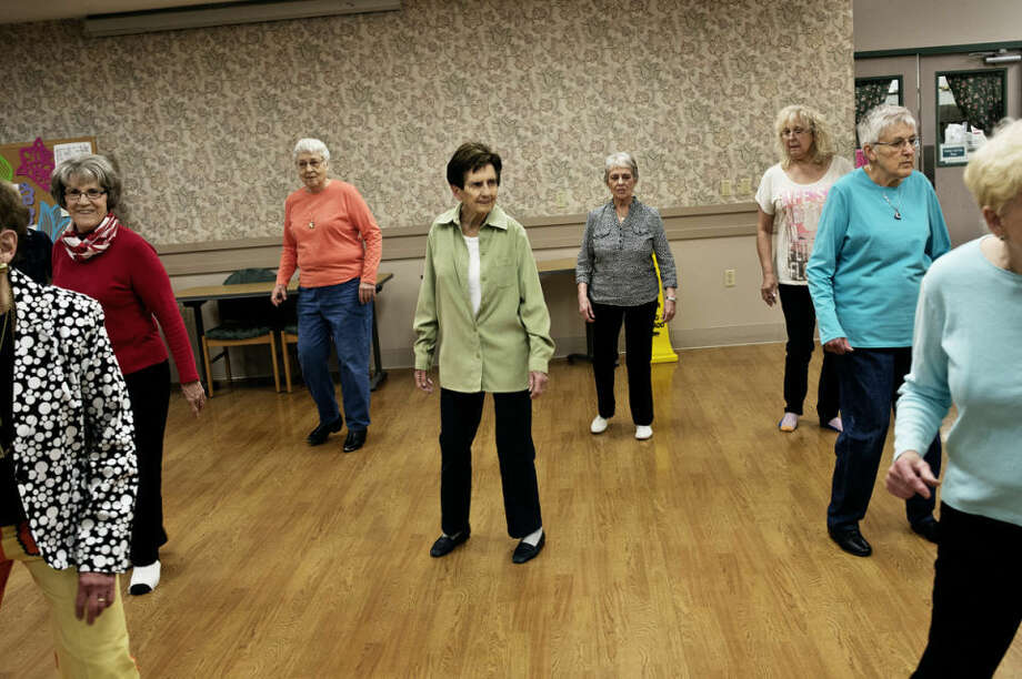 Grace DeVos, center, of Sanford, and other members of the Sanford Lake Line Dancers practice a routine Tuesday at Trailside Senior Center in Midland. Photo: Sean Proctor/Midland Daily News