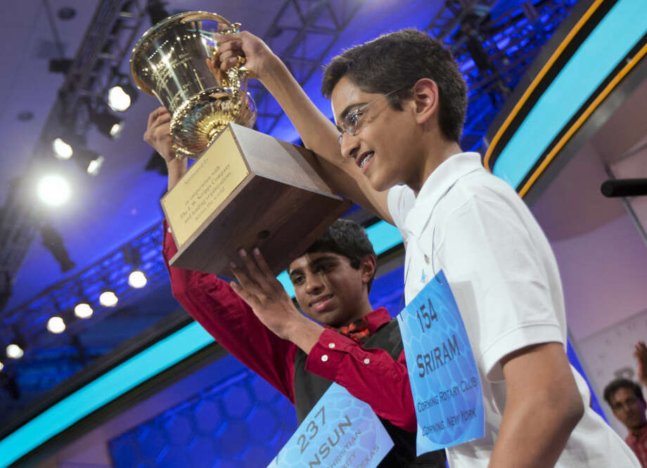 Ansun Sujoe, left, of Fort Worth, Texas, and Sriram Hathwar, right, of Painted Post, N.Y., raise their trophy after being declared co-champions of the Scripps National Spelling Bee, Thursday, in Oxon Hill, Md. Photo: AP Photo Manuel Balce Ceneta