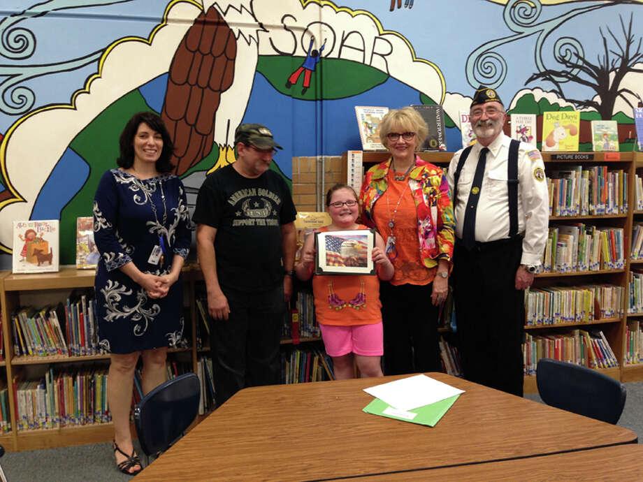 Pictured are Shannon Blasy, assistant principal; Les Novak, Eastlawn Honor Guard advisor; Sydney Grabinski; Bonnie Westervelt, Eastlawn principal; Rodney Lattimer. Photo: Photo Provided