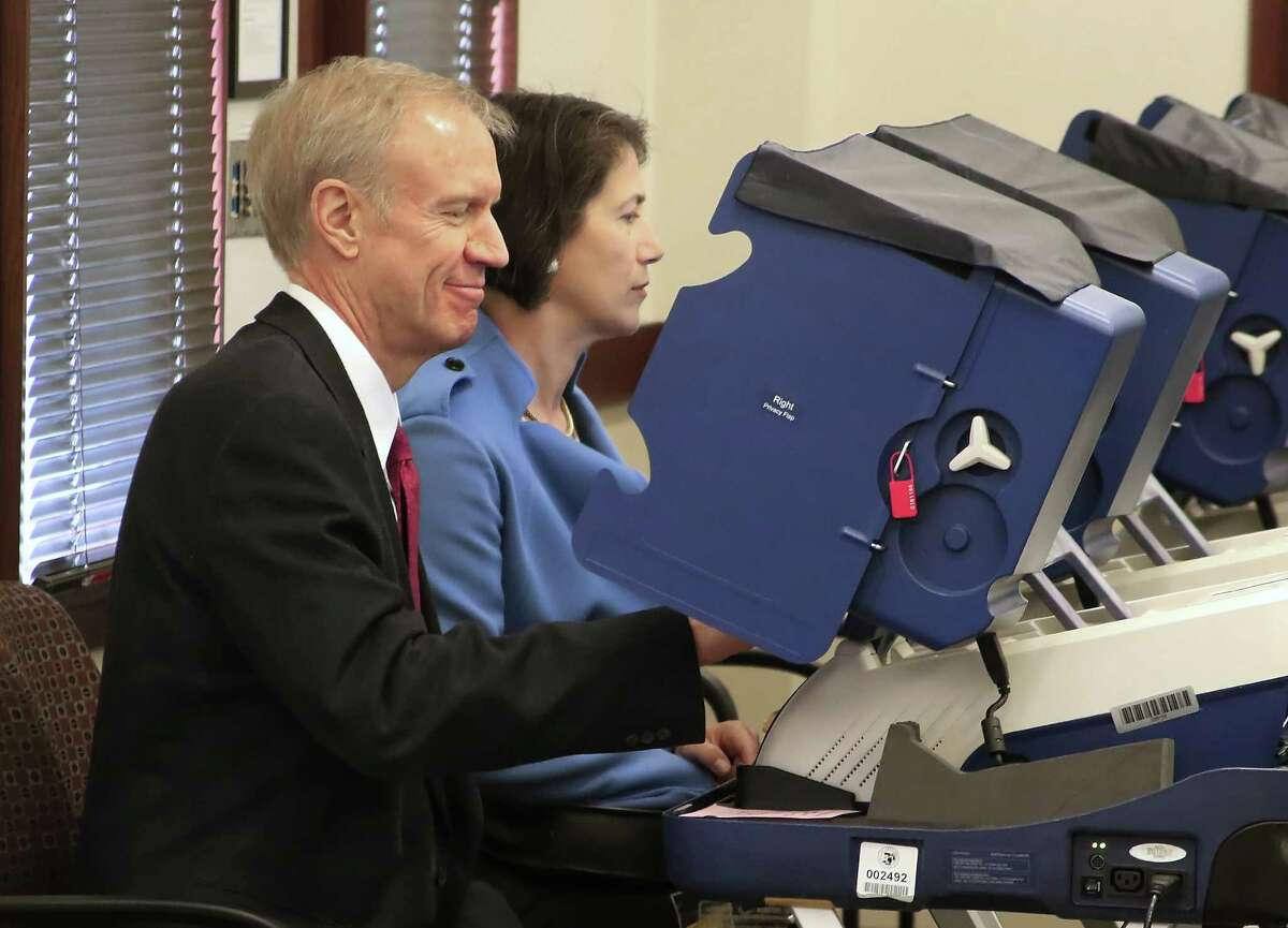 Illinois Gov. Bruce Rauner votes March 6 with his wife, Diana, in the 2016 primary election at an early voting site in Arlington Heights, Ill. Voters on the West Coast are forced to wait until the field is narrowed and front- runners are set.