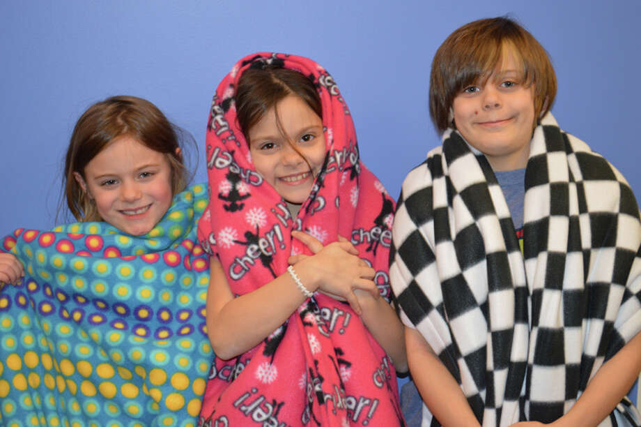 """Bree, Alicia, and Jack all wrapped up in their new blankets, kindly contributed by, thoughtful community member, Linda Kevra, proving once again that there are countless ways to touch the life of a child."""