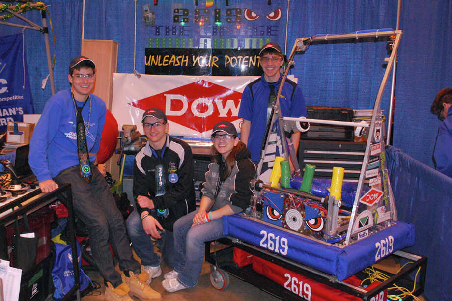 From left, Pierre Marché, Steven Keptner, Tonya Roenick and Eric Mason with this year's robot. Photo: Photo Provided