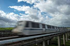 A BART train runs along Highway 4 between the Pittsburg-Bay Point and North Concord stations on Monday, March 21, 2016, in Concord, Calif. Transit officials said they havenít pinpointed a ìroot causeî for a track power-surge problem that halted service between the two stations starting last week.