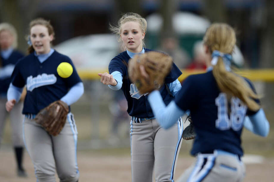 NICK KING   nking@mdn.netMeridian's Madi Cassiday, left, throws the ball to Blake Garner during the fifth inning in the first game of a double header Thursday at Bullock Creek High School. Photo: Nick King/Midland  Daily News