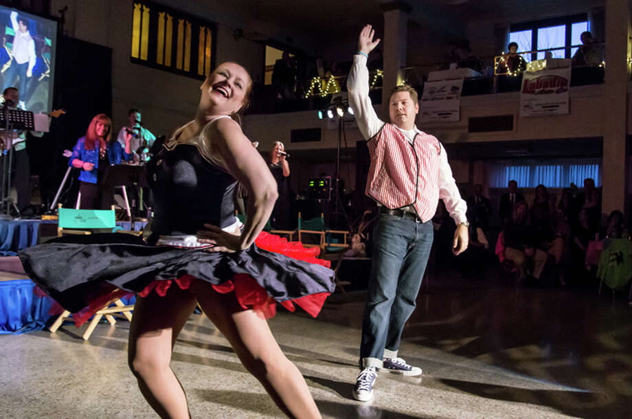 Mike Weinert of Garber Automotive Midland dances with his partner, Theresa Baker. Photo: Eric G. Fletcher