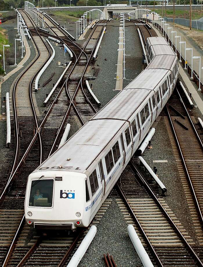 A BART rides over rails just north of the North Concord station on Monday, March 21, 2016, in Concord, Calif. Transit officials said they havent pinpointed a root cause for a track power-surge problem that halted service between the Pittsburg-Bay Point and North Concord stations. BART was experiencing similar problems on Friday, April 14, 2017. Photo: NOAH BERGER / SAN FRANCISCO CHRONICLE