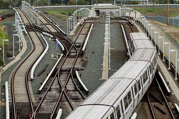 """A BART rides over rails just north of the North Concord station on Monday, March 21, 2016, in Concord, Calif. Transit officials said they haven't pinpointed a """"root cause"""" for a track power-surge problem that halted service between the Pittsburg-Bay Point and North Concord stations."""