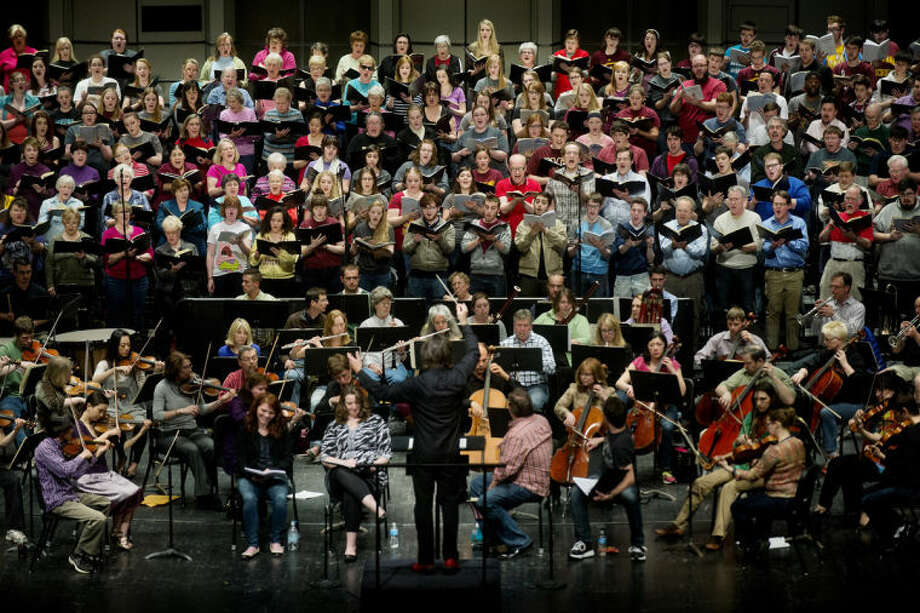 The Midland Symphony Orchestra rehearses Friday at the Midland Center for the Arts in preparation for their presentation of 'Ode to Joy,' which they are performing tonight at 8 p.m. Four guest soloists, Central Michigan University Concert Choir and Chamber Singers, and the Center Stage Chorale and Camerata Singers will join the orchestra to perform Beethoven's masterpiece. There is a pre-concert talk at 7 p.m before the event. The show is sold out. Photo: Nick King/Midland  Daily News