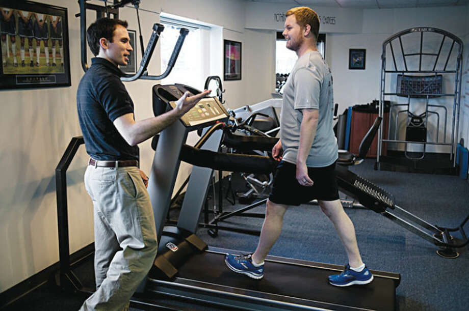William Suits of Active Orthopedics Physical Therapy talks with Daily News reporter Tony Lascari as he warms up on a treadmill. Active Orthopedics offers running analyses for patients to assist them with their running form, which can be a cause of injury. Photo: Neil Blake/Midland  Daily News