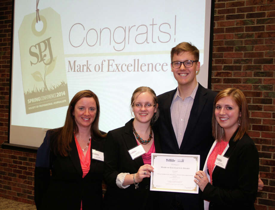 Photo providedFrom left, Tracy Burton, Anna Palm, Mark Fairbrother and Jennifer Liedel receive their award from the Society of Professional Journalists Saturday at Ohio State University.