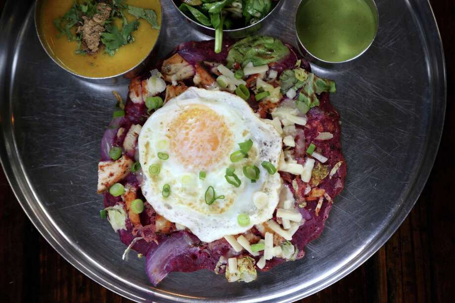 Beet Uttapam pancake bottom, brussels sprouts, carrots, red onion, black pepper chicken, topped with Amul cheese, over easy egg, green onions, served with Dal, lentil soup and Pondicheri salad, and cilantro chutney,  at Pondicheri Restaurant, Wednesday, March 16, 2016, in Houston, Texas. ( Gary Coronado / Houston Chronicle ) Photo: Gary Coronado, Staff / © 2015 Houston Chronicle